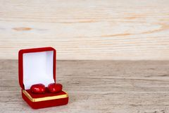 Two hearts in gift box on wooden table. Two hearts in gift box on rustic wooden table Stock Photo