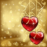 Two hearts on golden background Royalty Free Stock Photos