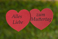 Two hearts on green background, Much love, Mother's Day Stock Images