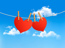 Two hearts hanging on a rope. In front of a sky. Valentines day vector Royalty Free Stock Image