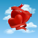 Two hearts hovering in clouds Royalty Free Stock Photography