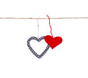 Two hearts hung up on the string. Isolated over white Stock Photography