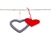 Two hearts hung up on the string. Isolated over white Stock Images