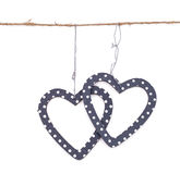 Two hearts hung up on the string Stock Photography