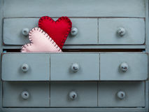 Two hearts inside a drawer in a dresser Royalty Free Stock Photography