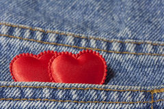 Two hearts in  jeans pocket Stock Photography