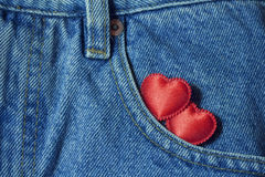 Two hearts in  jeans pocket Royalty Free Stock Photos