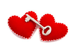Two hearts and a key. To signify opening of one's heart to love Stock Images