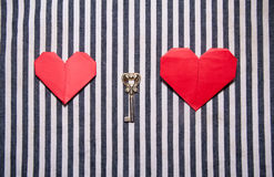 Two hearts and a key Royalty Free Stock Photography