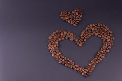 Two hearts lined from coffee are located to the right of the center of the background royalty free stock images