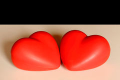 Two hearts for love. Two red hearts as a symbole for love Royalty Free Stock Image