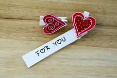 Two hearts on clothes peg royalty free stock photography