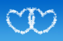 Two hearts love shaped clouds Stock Image