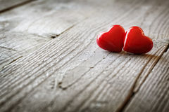 Two hearts in love. Two hearts on a wooden background concept for love, dating and romance with coyspace Stock Images