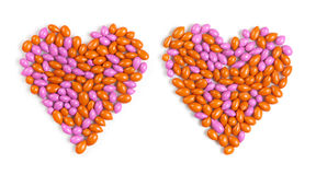 Two hearts made from dragee candies Royalty Free Stock Photo