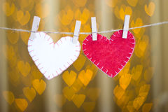 Two hearts made of felt on clothespins. Stock Images