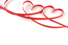 Two hearts made of red paper ribbon isolated on white background Stock Photos