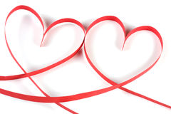 Two hearts made of red paper ribbon isolated on white background Stock Photography