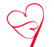 Two hearts made of red ribbon Stock Photo
