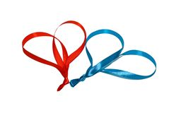Two hearts made of ribbons. On a white background Stock Photos