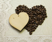Two hearts made of wood and made of coffee beans Royalty Free Stock Photo