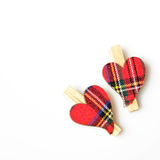 Two hearts with the material, with wooden clasps Royalty Free Stock Image
