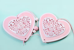 Two hearts on mint color background Stock Image