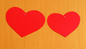 Two hearts nailed to board Stock Photo
