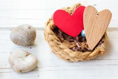 Two hearts on nest - Family and Valentine's day concept.  royalty free stock photo