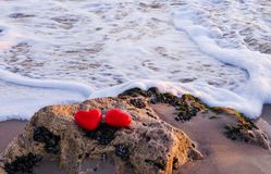 Two hearts by the ocean Stock Photos