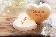 Two hearts on old wood, message happy valentines day Royalty Free Stock Image