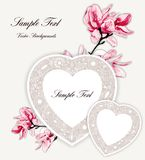 Two hearts with ornament and Magnolia on beige background. Royalty Free Stock Photos