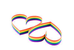 Two hearts,paint  of a colour gay flag. Idsolated. Stock Photos