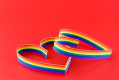 Two hearts,paint of a colour gay flag in red. Two hearts, paint of a six-colour gay flag.Focus on front part first heart. All in focus royalty free stock photo