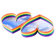 Two hearts, paint of a six-colour gay flag. Royalty Free Stock Photos