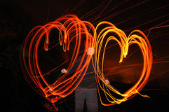 Two Hearts painted by fire Royalty Free Stock Image