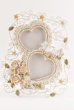 Two hearts picture frame with two doves and little roses Royalty Free Stock Photos