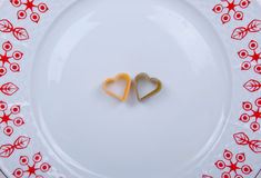 Two hearts. Two pieces of heart shaped pasta Stock Photo