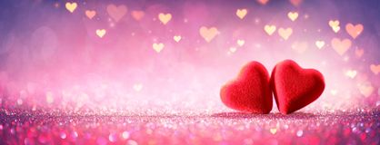 Two Hearts On Pink Glitter In Shiny Background stock photo