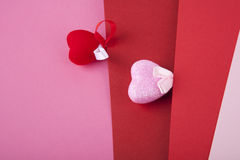 Two hearts on pink and red. Two hearts on multicolored background Stock Image