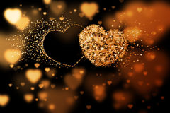 Two hearts and place for your text. Golden background with bokeh effect Stock Image