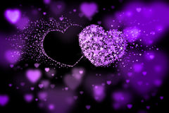 Two hearts and place for your text. Purple background with bokeh effect Royalty Free Stock Photography