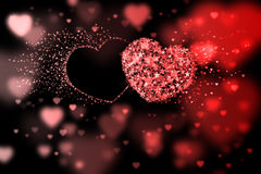 Two hearts and place for your text. Red background with bokeh effect Stock Photography