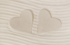 Two hearts print in the sand. Summer beach and vacation concept. Two hearts print in the white sand. Summer beach and vacation concept for a background Royalty Free Stock Photos
