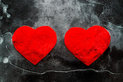 Two hearts. Two red hearts on a background of black ice Stock Photo