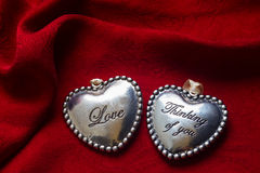 Two hearts red  background Stock Photos