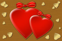 Two hearts. Two red hearts with bows on the wooden texture Royalty Free Stock Photos