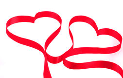 Two hearts from red ribbon Royalty Free Stock Photography