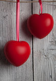 Two hearts on red ribbon Stock Images