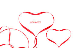 Two hearts with red ribbons Stock Photo